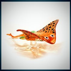 Glass Animal Figurine: a stingray marine collectible.  Handmade, Stanley looks delicate, but is as strong as borosilicate glass.. $15.00, via Etsy.