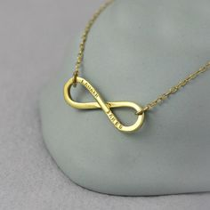 Handmade in Brighton, as a symbol of everlasting love, this gold necklace features an infinity charm engraved with your names or wedding date. Infinity Charm, Infinity Necklace, Fine Jewelry, Jewelry Making, Jewellery, Unique Anniversary Gifts, Personalized Jewelry, Handmade Necklaces, Hand Stamped