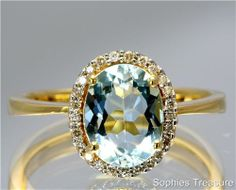 Victorian Genuine Aquamarine And Diamond Solid 18k Yellow Gold Engagement Ring I love the mixed stones... aquamarine and colored diamonds are my faves...