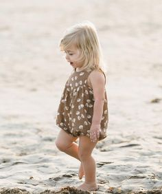 Cocoa romper with seashell print.  Button back closure and snaps along inseam.  Elastic leg openings.   100% cotton crepe