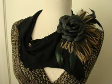 Black suede collar with hand made leather rose and feathers.