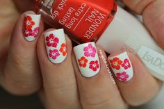 Hibiscus  Nails stamped on with IsaDora creme polishes and stampingplate XL F.