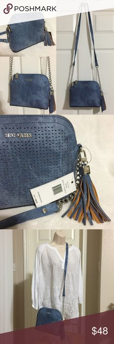 """Steve Madden BMarylin Crossbody Purse Denim blue NEW WITH TAGS Authentic Steve Madden BMarylin Dome Crossbody Purse • RETAIL $68.00 • Color: Denim Blue • Dimensions: 9""""W x 7.5""""H x 3.5""""D with 23"""" strap drop • Interior: 1 zipper compartment & 1 slip pocket • Top zip closure, Removable Tassel and Silver tone hardware * Comes from a smoke free pet free environment  🎀 I have more STEVE MADDEN, Check out my other items!   ❤ LIKE ME ON FACEBOOK @MarianTNoonan Steve Madden Bags Crossbody Bags"""