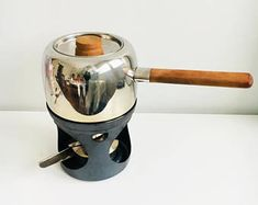 A collective /1.5 liter vintage teak & steel fondue pot designed by Finnish famous designer Timo Sarpaneva  for OPA, 1970s, Made in Finland