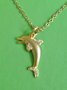 Gold Dolphin and Crystal Necklace by joytoyou41 on Etsy. Pretty