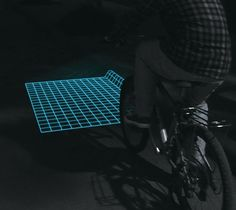 Lumigrids While Cycling / Lumigrids is an LED projector for bicycles that hopes to improve safety during night riding. http://thegadgetflow.com/portfolio/lumigrids-while-cycling-tba/