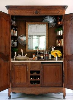 vintage piece of furniture turned into a bar...sink and all.