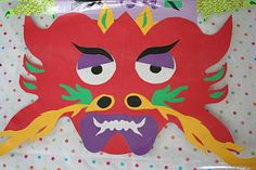 Cut Paper Dragons for Chinese New Year from Pink and Green Mama