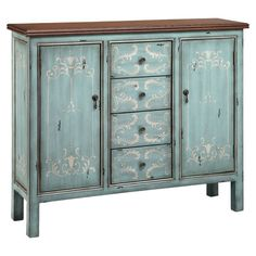Lend a touch of country-chic charm to your dining room or den with this lovely sideboard, features 2 doors and 4 drawers with hand-painted scroll details.