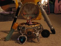 the music box from the animated film Anastasia a sonic pen and sonic screwdriver from Doctor Who a Swarvoski crystal Heart of the Ocean from Titanic an Evenstar from The Lord of the Rings a Aztec gold. Anastasia Music Box, Nerd Geek, Geek Out, Aztec Gold, The Last Avatar, Ocean Heart, Heroine Photos, Sailor Moon Art, Fandom Outfits