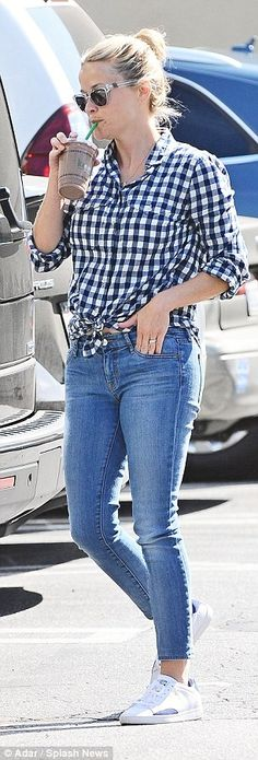Casually chic:The Walk The Line actress headed out for a shopping trip in a pair of tight blue jeans that were cropped at the ankle with a blue and white checked short