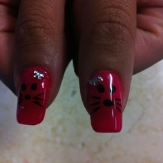 Hello Kitty Nails - Close-up of Hello Kitty Face with Nail Art Black Polish with rhinestone bow, Hot Pink Gelish Polish  By Jade Phuong's Nail Artist Team at Blackhawk Nail and Spa at Blackhawk Nail and Spa