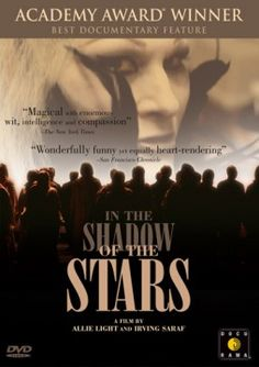 """In the Shadow of the Stars Directed by Allie Light, Irving Saraf, 1991 Magical, with enormous wit, intelligence and compassion"""" - The New York Times  Winner of the Academy Award® for Best Documentary Feature and lauded by the San Francisco Chronicle as """"wonderfully funny yet equally heart-rending,"""" IN THE SHADOW OF THE STARS is a hilarious and affectionate look at the path to stardom inside the competitive world of Grand opera."""