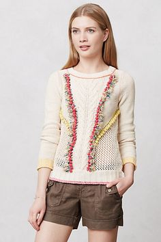 Pomfringe Pullover Anthropologie.  Wish I could get a zoomed in view of this sweater as the pompom detailing is so fun.