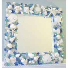 Glass and seashell mirror frame.   http://therealcraftychica.blogspot.com/