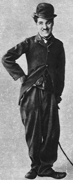 """Charlie Chaplin as """"The Tramp"""", in 1915 cinema,  a character he created. He was considered one of the most important figures in the film industry. His career spanned more than 75 years, from childhood during the Victorian Era to his death in 1977."""