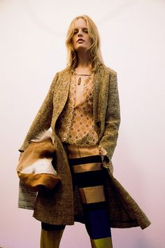Hanne Gaby Odiele in a carpet coat and seventies print backstage at Dries Van Noten SS15 PFW. More images here: http://www.dazeddigital.com/fashion/article/21925/1/dries-van-noten-ss15