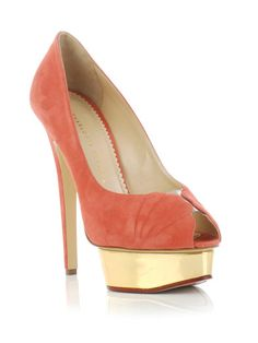 It's as if this stylish shoe is sitting on a golden stage just waiting for me to buy it! :)