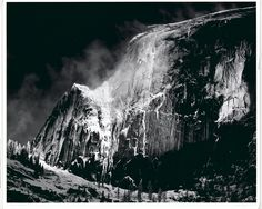"""Ansel Adams' Half Dome, Blowing Snow, Yosemite National Park, is a classic landscape photograph, one that draws upon decades of dramatic imagery touting the far West as the ultimate expression of an expanding American empire. It is also a textbook example of what Adams famously referred to as the """"Zone System,"""" a technique that transforms the photographic surface into a study in contrasts. By manipulating the light-sensitive silver within the film and the printing paper, Adams created a glea... Famous Photographers, Landscape Photographers, Sierra Nevada, Ansel Adams Quotes, Ansel Adams Photography, Photography Ideas, Urban Photography, Color Photography, Outdoor Photography"""