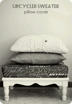 Sweater pillows and love the bench with cushion.