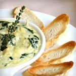 Atkins Spinach-Artichoke Dip. Only 5.7g Net Carbs. Serve with celery, toasted Atkins Bread or parmesan cheese crisps!