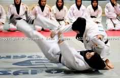 Members of Iranian women national Judo team practice while wearing Islamic hejab train in Enghelab Sport Complex in Tehran, Iran, on June 10, 2007. document IRAN/Nikoo Harf Maher