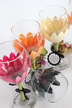 wine glasses painted like flowers-i want to to this with juice glasses and paint with something from the theme. It would be a good parting present.