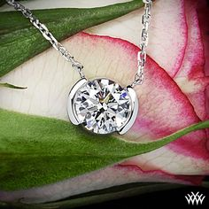 """Eternally elegant, this beautiful """"Half-Bezel"""" Diamond Pendant is the perfect option to display your diamond to its full magnificence. The gentle bezel design insures that your diamond is always secure and remains the center of attention. Featured here is our """"Half-Bezel"""" Diamond Pendant set with a 0.718 F SI2 A CUT ABOVE Hearts and Arrows Diamond."""