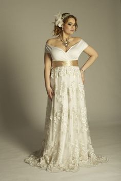 This is an off the Shoulder Plus Size Wedding Dresses with Short sleeves and empire waist line. We have many plus size wedding gowns for a curvy bride to consider. Custom plus size bridal gown designs & inexpensive replicas of haute couture wedding gowns are also available at www.dariuscordell.com