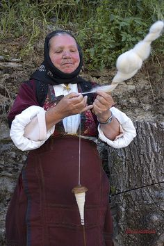 Desulo, Barbagia. Women stronger than time.  Sardinia, Italy Note top whorl spindle with hook.