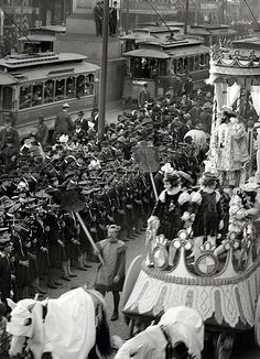 Mardi Gras Celebration...New Orleans 1900 Notice the street cars on Canal, where now there are buses and notice the soldiers are 2 deep.