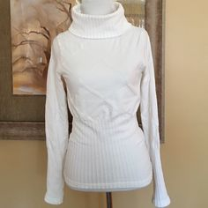 "FINAL SALE Venus Off-White Turtleneck Size S/M This is a great turtleneck from Venus in a pretty cream color.  Made of a nylon/spandex blend, it's very form fitting.  It has a cable-knit design & it measures 20"" from center neckline to bottom, 14"" from armpit to armpit & the sleeves are 23"" from shoulder to wrist.  It's a size Small/Medium & can easily fit both. Worn & washed a few times it is still in good condition but the inside label has worn off.  Please note the last picture is not the…"
