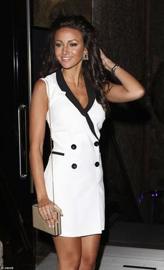 Ready to go: Michelle looked polished in her evening ensemble, with her dark hair styled into curls