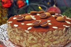 """Dragii mei, am facut acest Tort Toffifee cu gandul la voi. Si cu gandul la Bogdi, care adora aceste bombonele de caramel, umplute cu nuga si ciocolata. Pentru ca noul an sa ne gaseasca mai veseli, mai ancorati intr-un decor dulce si optimist :P Nu va spun prea multe, ca altadata, ci doar un simplu si din inima: """"La multi ani!!!!!!"""" Si mari, mari multumiri pentru ca mi-ati incalzit inima cu prezenta voastra!!! Ingrediente: Pentru crema: - 300 g ciocolata cu lapte sau cu cacao 50% - 1..."""