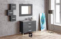 Mueble de baño modelo GARONA de TORVISCO GROUP de 100cms con tres cajones y en acabado gris mate. Con espejo OCEAN, foco ERIC, encimera DUBAI y armaritos auxiliares de 35cms. Del catálgogo BATHONE.