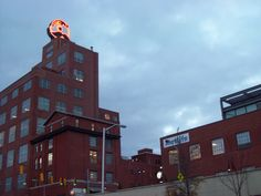 historic baltimore breweries | 27-foot tall neon logo of Mr. Boh sits atop the Natty Boh tower in ...