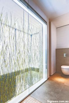 Designers at Wirges-Klein Architekten in Germany created a floor to ceiling bathroom wall feature with Varia Seaweed that lets the space flood with natural light . Bathroom Paneling, Bathroom Wall Panels, Shower Wall Panels, Wall Tiles, Light Bathroom, Bathroom Faucets, Wall Sconces, Bathrooms, Plastic Wall Panels