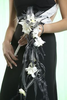 Sceptor prom bouquet with trailing ribbons and orchid blooms. Featured in Prom Flowers Designer Spotlight: Suzie Kostick AIFD, PFCI, CFD. Prom Bouquet, Bouquets, Corsage And Boutonniere, Prom Flowers, Spotlight, Homecoming, Orchids, Bloom, Corsages