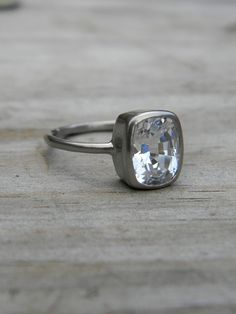 Where was this when we were looking at engagement rings 11 years ago? So simple, so perfect! Plus, a sapphire, even better!