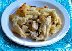 Baked Chicken Alfredo. Chicken and Penne pasta covered with creamy alfredo sauce, topped with grated parmesan and mozzarella.