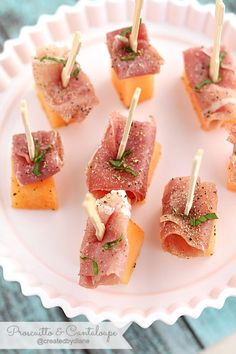 Easy and delicious, these proscuitto and cantaloupe appetizers will disappear off the plate just about as soon as you put the picks into them.