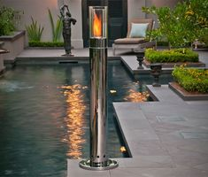 This sleek freestanding fire pillar is a dramatic fusion of a medieval torch and a fireplace all-in-one!