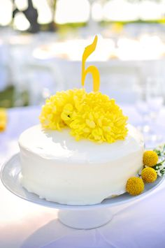 Cake centerpiece with floral accent on top!