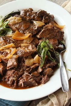 These slow cooker, all apart, saucy beef short ribs are sure to be a crowd pleaser.