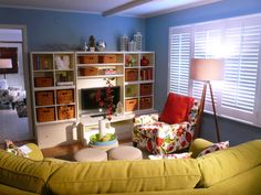 Great idea for kid friendly living room! i love the baskets on shelves around the tv to keep toys, etc in. and fun colors too!
