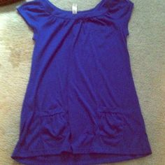 Cap sleeve top Has small front pockets. Kind of long so would be really cute over leggings Tops