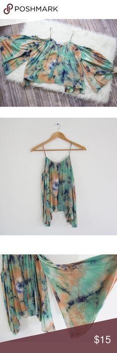 "Stella Laguna Beach Tie Dye Cold Shoulders Top Cute boho cold shoulders top with bell sleeves and a small key hole on front detailed with fringe.  Size: S Brand: Stella Laguna Beach Material: Rayon Condition: Great  MEASUREMENTS  (Taken while laying flat)  Length: (from shoulder to hem) 25""  Chest: (underarm to underarm) spreads to 25"" Stella Laguna Beach Tops Blouses"