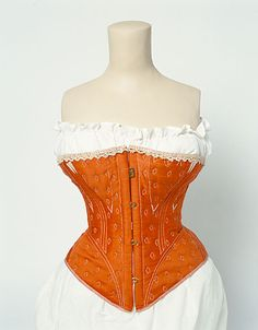 Here's a quilted corset in orange with white details at the top, 1860-1870