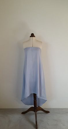 A beautiful, floaty, cool dress made using an almost luminous pale blue organic double gauze fabric, incredibly flattering against pale or tanned skin. Ever so slightly transparent, this simple design with graduated hem is discreetly flattering. Perfect for trips to the beach or sightseeing in warmer climates.  Machine wash on wool cycle.  Pictured in size S (to fit bust 34-36 inches)