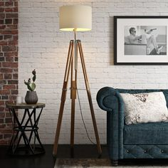 With its tripod design, this industrial floor lamp base fits effortlessly into any scheme. An eye-catching addition to your home, this floor lamp base features an antique-style wooden tripod design. Make a style statement in any room with this wooden floor lamp base, showcasing an industrial-style tripod design.